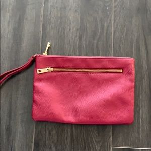 Plum clutch wristlet with gold coloured zippers